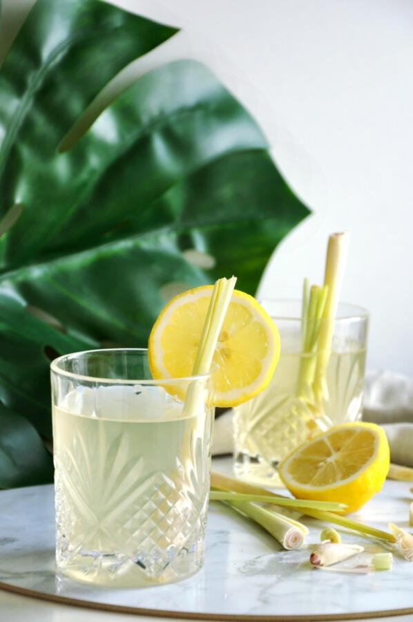 Ginger lemon fizz cocktail with lemongrass straw