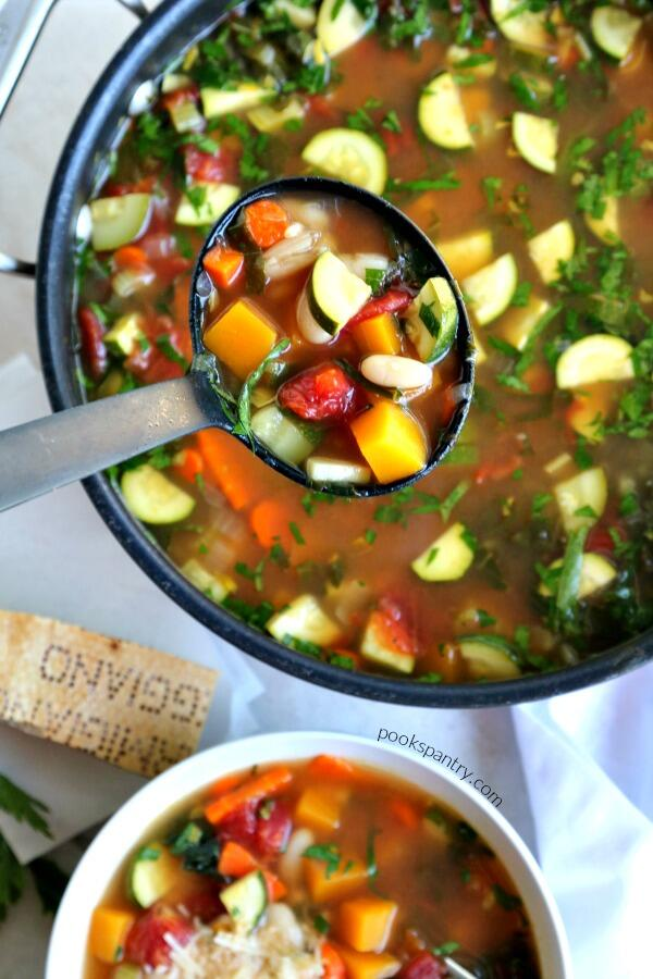 pot of autumn minestrone soup with ladle