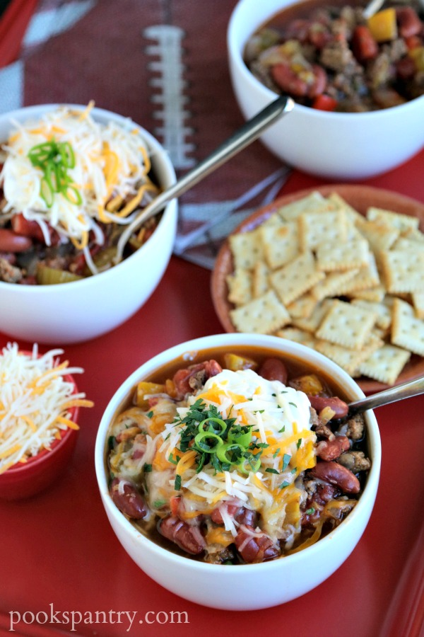 bowls of simple turkey chili with sour cream and cheese