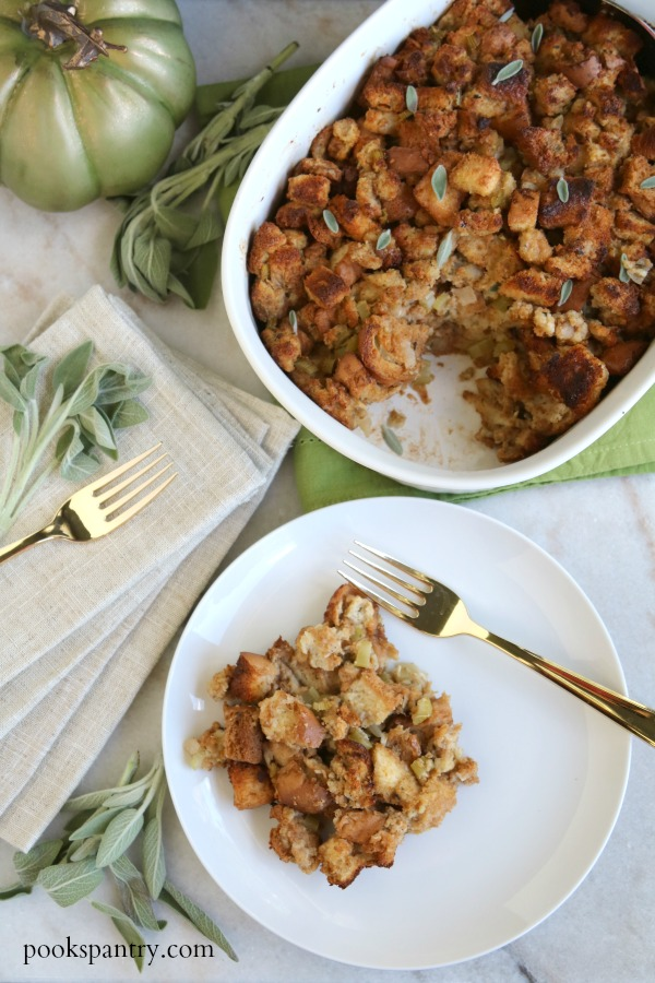 stuffing on white plate with gold fork and linen napkin