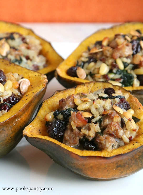 stuffed acorn squash halves on white platter