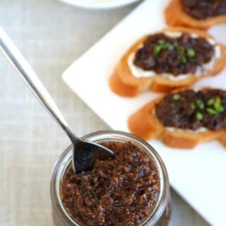 bacon jam in jar with plate of crostini