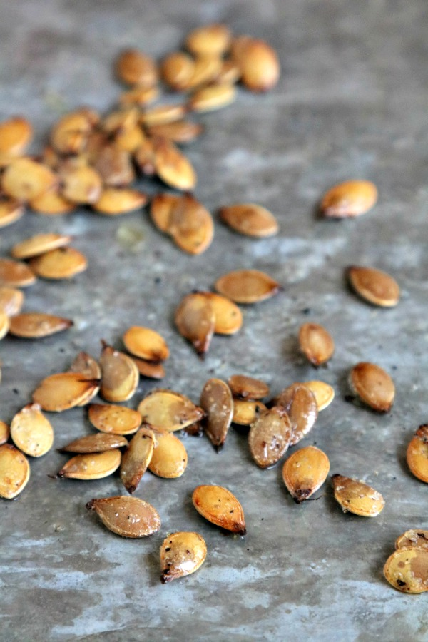 roasted acorn squash seeds on baking sheet
