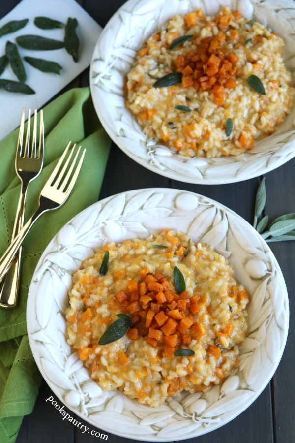 two bowls of butternut risotto with fried sage