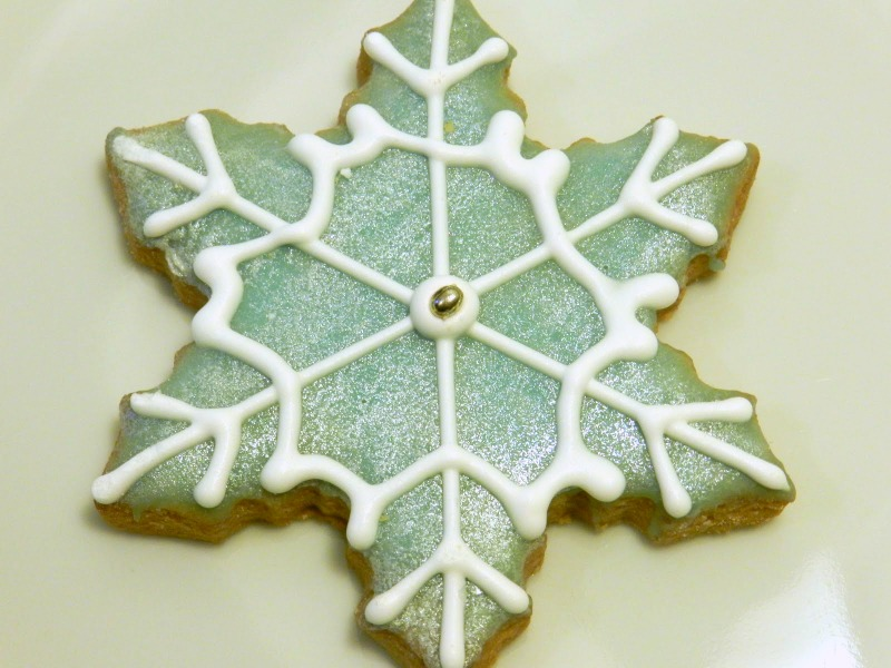 roll out sugar cookie snowflake with royal icing