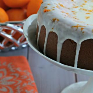 clementine cake with glaze on cake stand