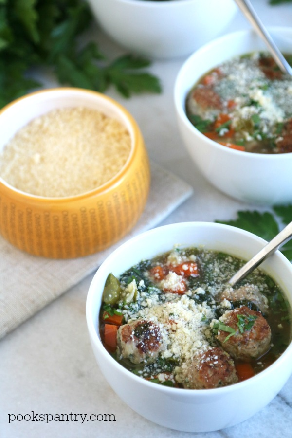 Italian wedding soup in white bowls with parsley