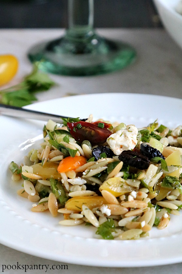 close up of orzo pasta salad with fork