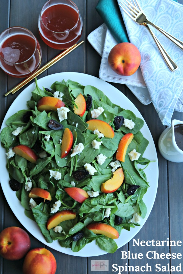 Spinach salad is my favorite way to eat this leafy green. Topped with fresh and dried fruit, a zingy dressing and a few crunchy, toasted almonds.  We've all seen or eaten the salad with strawberries, but this spinach salad uses perfectly ripe stone fruit and tangy blue cheese.