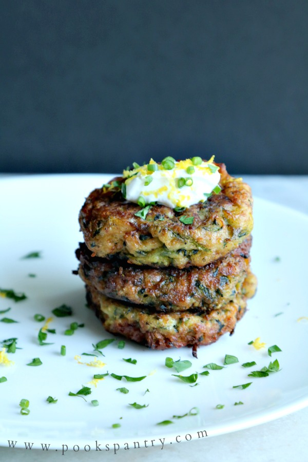 stacked zucchini fritters on plate