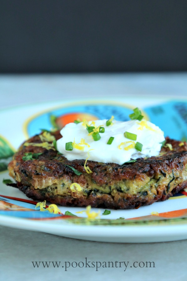 zucchini cake on plate with sour cream