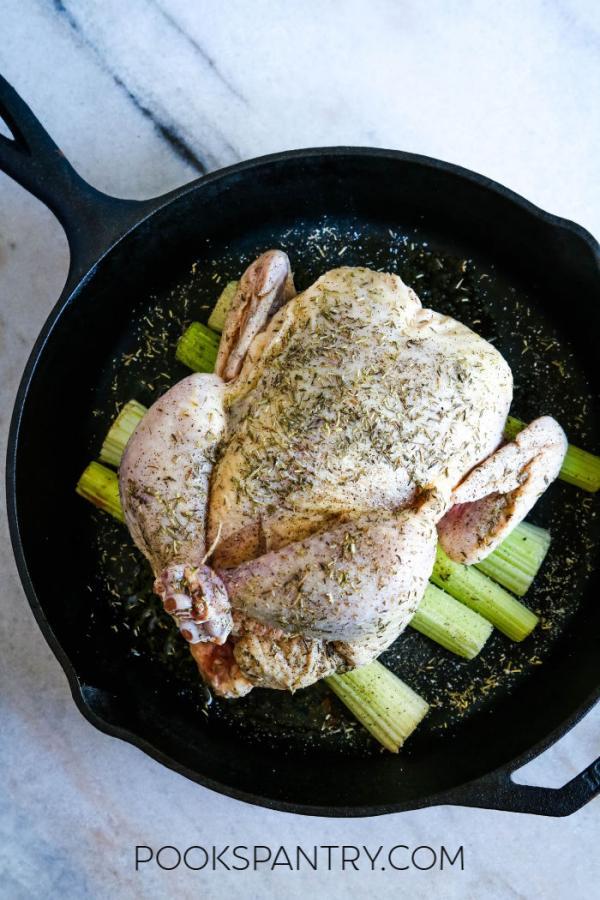 raw chicken in cast iron pan