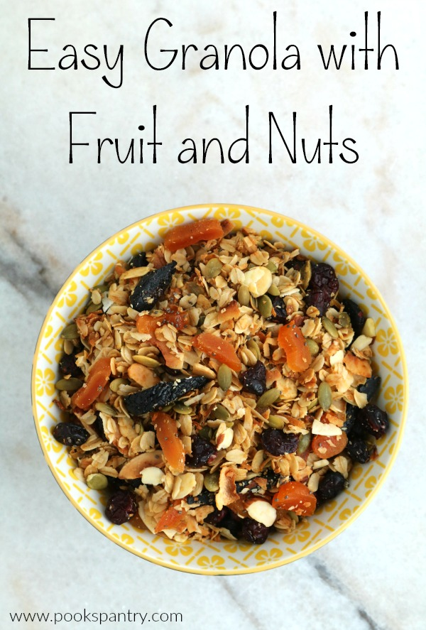 bowl of fruit and nut granola on marble counter
