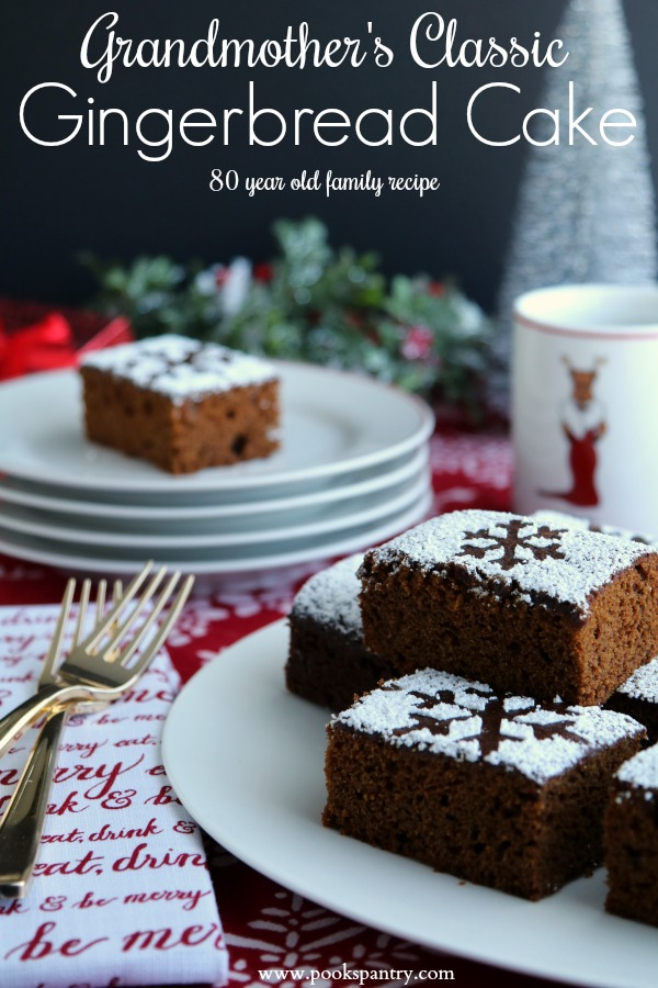 gingerbread cake recipe on white platter with stacked plates