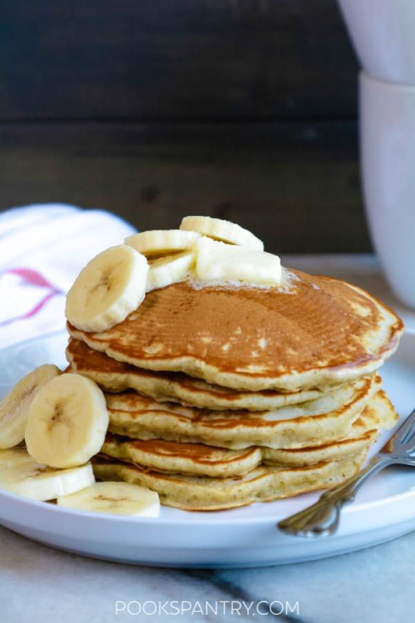 banana pancakes on white plate