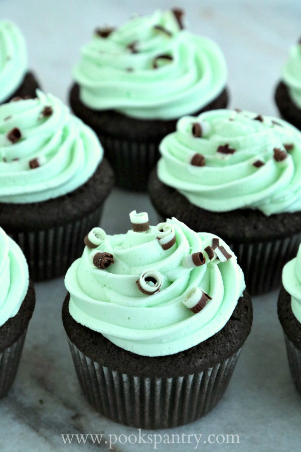 devil's food cupcakes with creme de menthe buttercream on marble counter