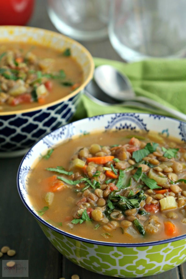 lentil soup in green and white bowl