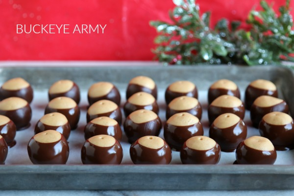 ARMY OF BUCKEYES ON SHEET PAN WITH RED BACKGROUND