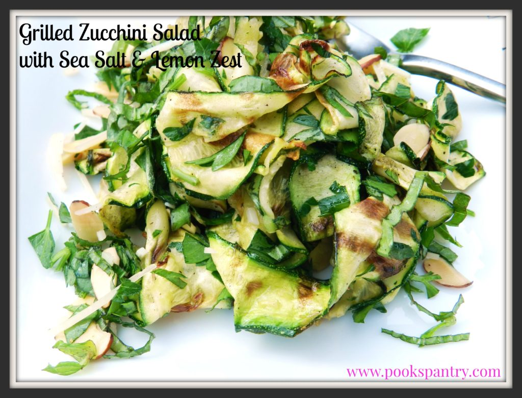 Grilled Zucchini Salad with lemon on white plate