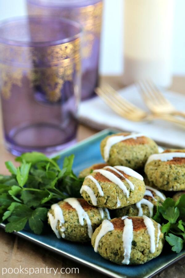 baked falafel with tahini yogurt dressing drizzled over top