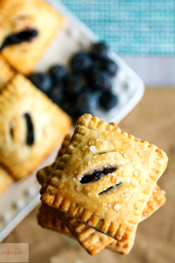 stacked mini blueberry pies
