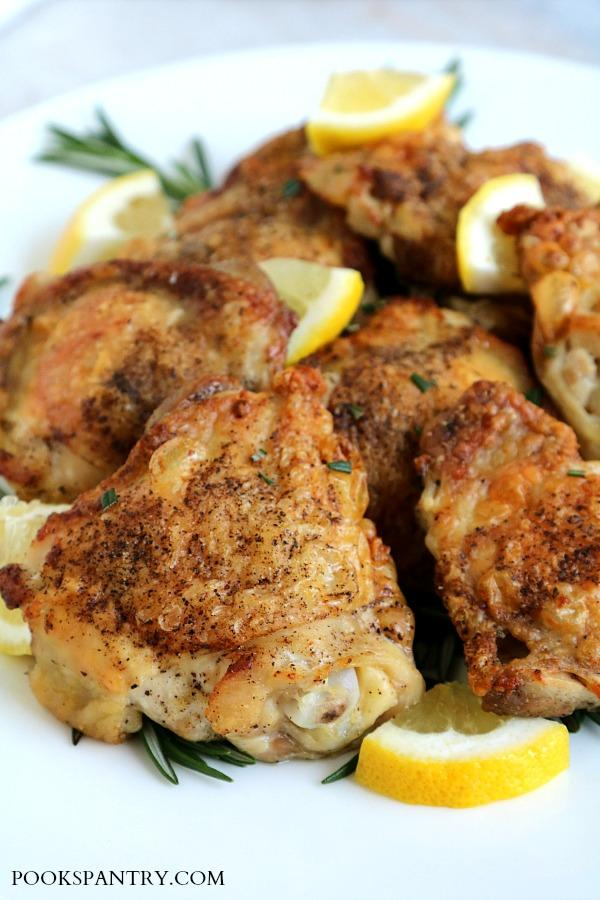 rosemary lemon garlic chicken thighs on platter