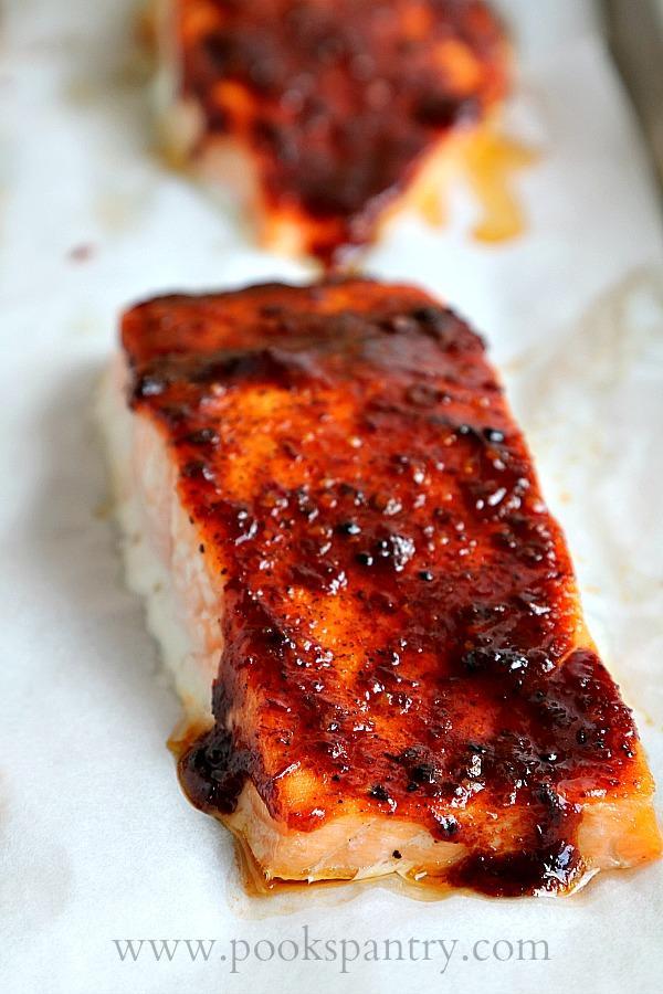 portion of honey chipotle salmon on sheet pan