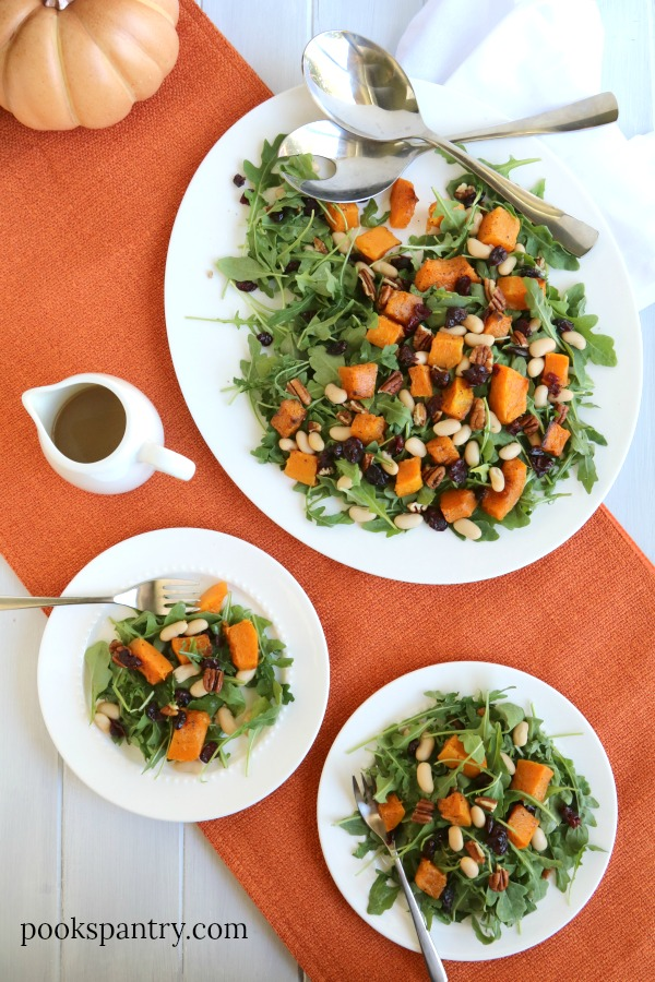 overhead view of butternut squash arugula salad