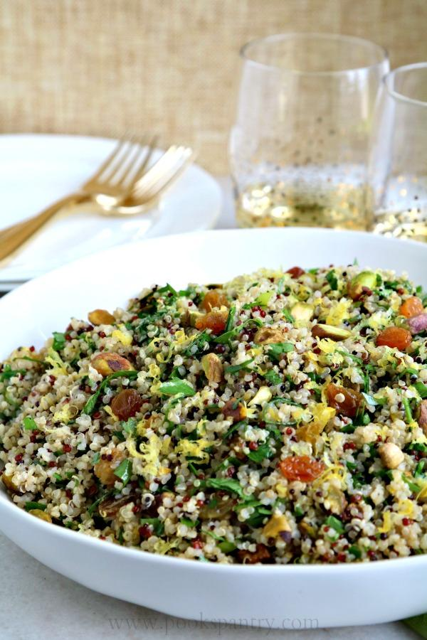 quinoa salad in bowl with gold forks in background