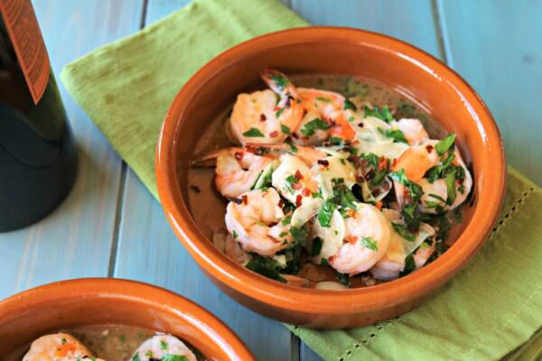 Spanish garlic shrimp in terra cotta dishes