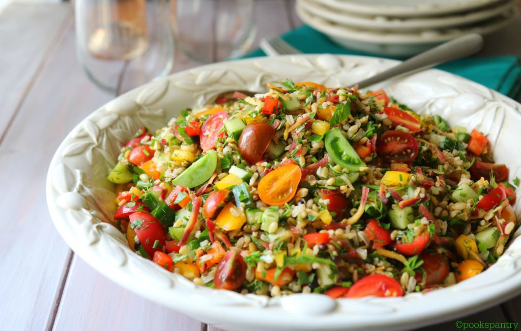 large bowl filled with summer grain salad