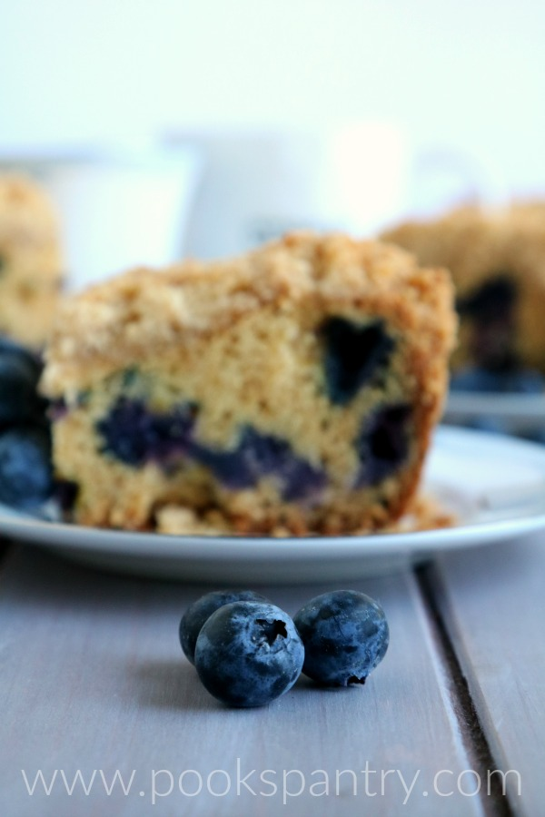 blueberries with coffee cake in the background