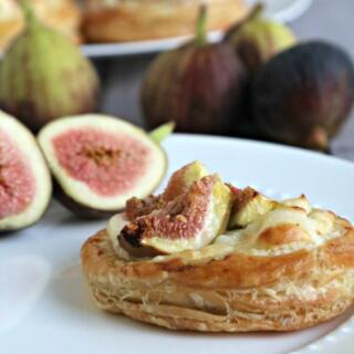 side view of fig puff pastry tartlet with sliced fig on plate