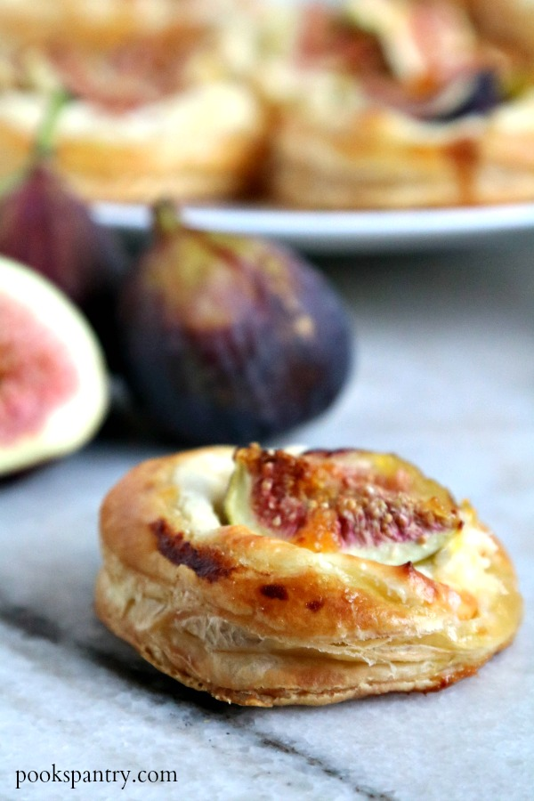 fig tart with figs in background