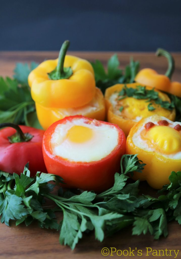 baked eggs in pepper cups with herbs
