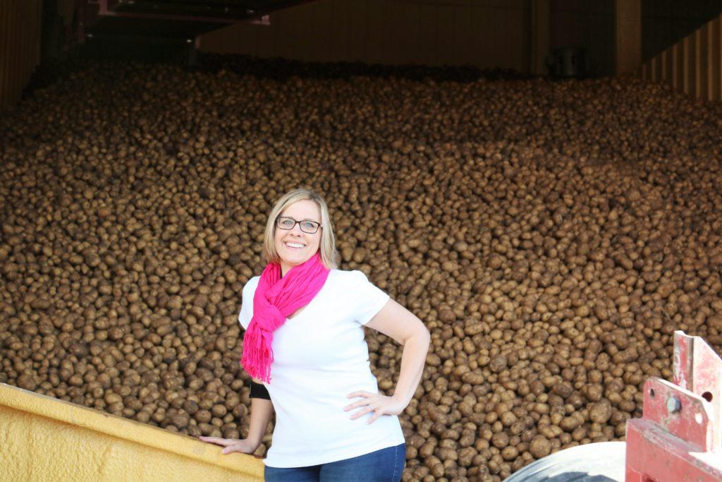 cheryl in front of potato silo