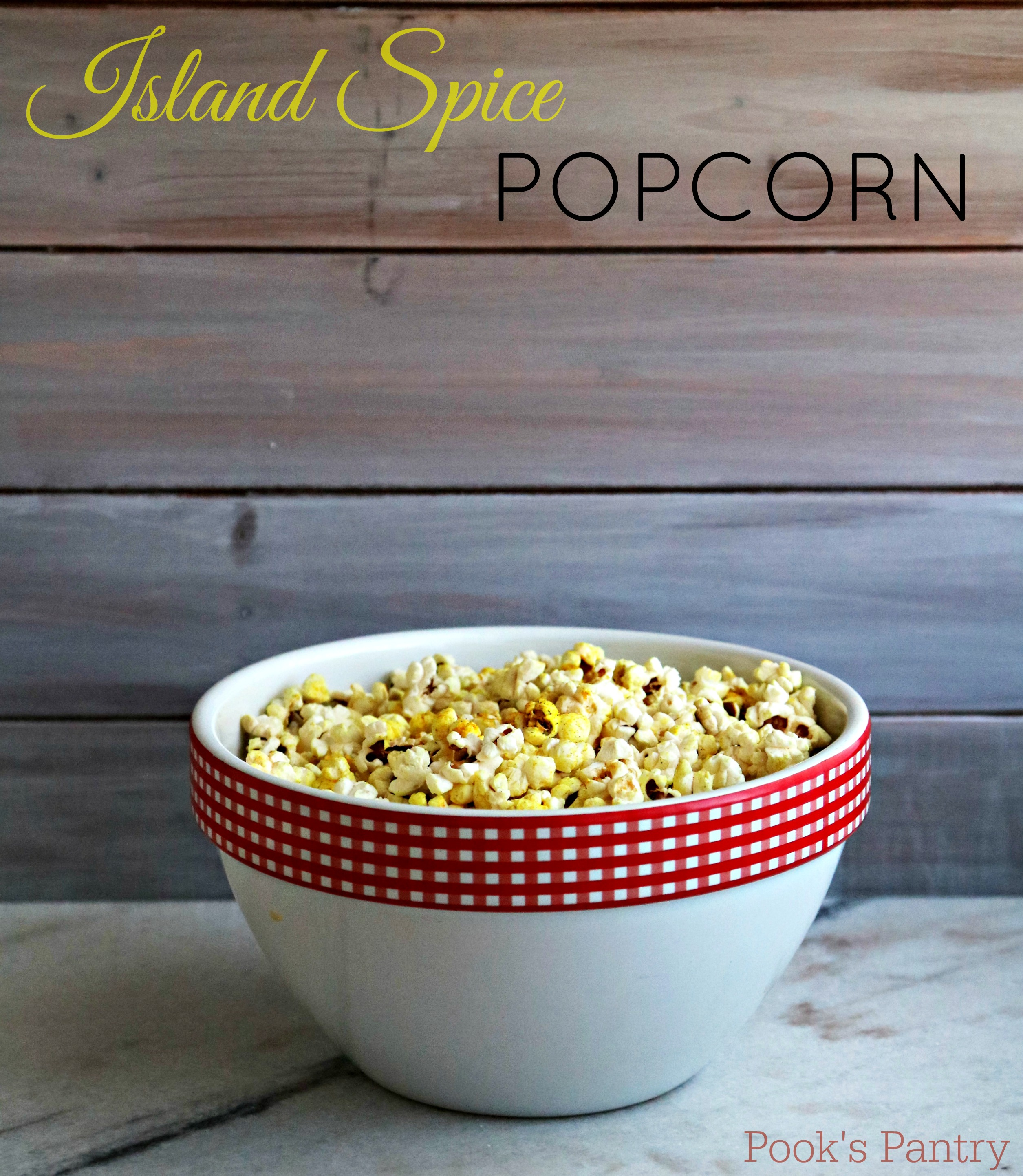 coconut oil popcorn in white bowl with red checkered rim