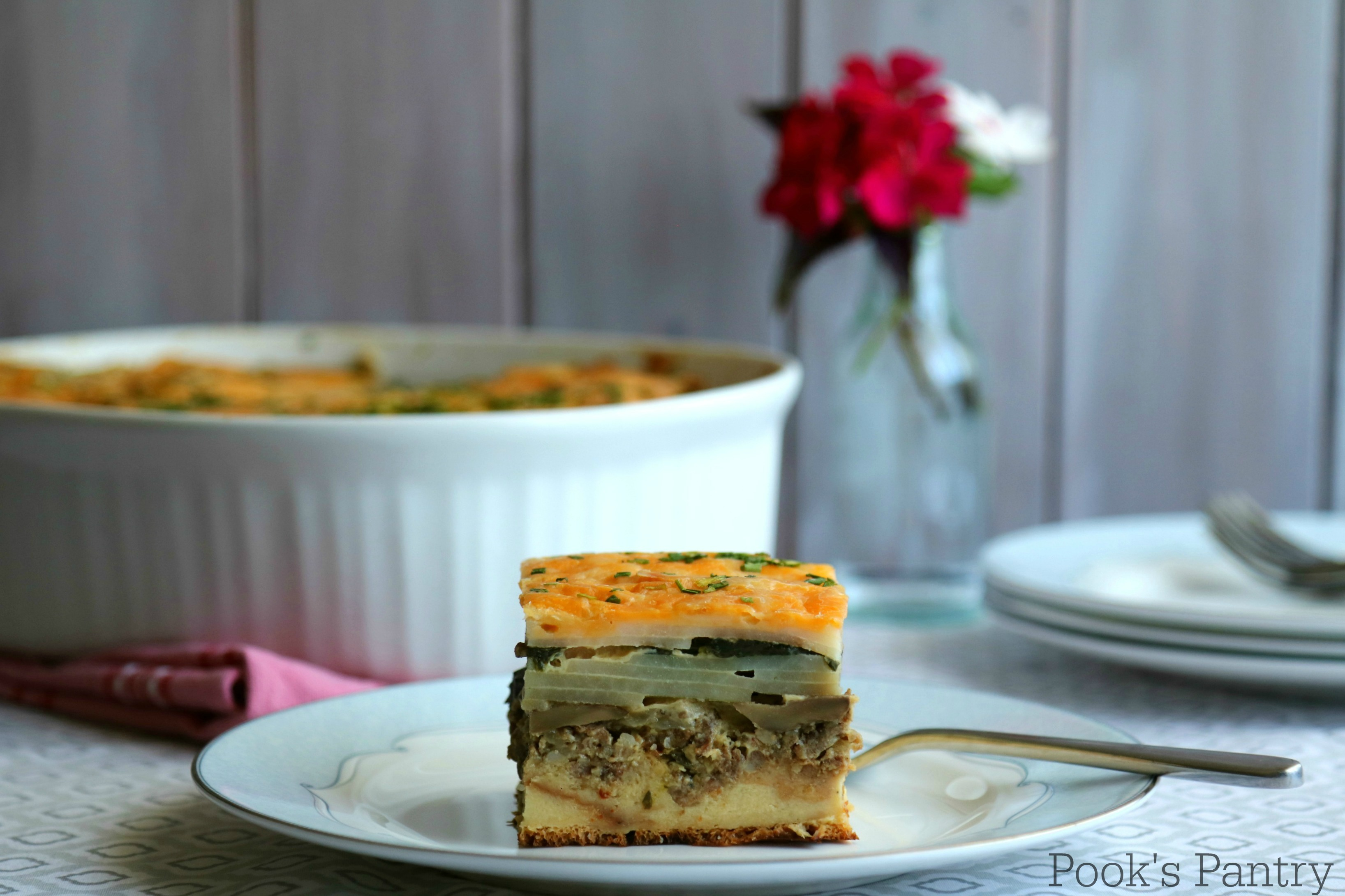 Breakfast Casserole slice on plate with fork