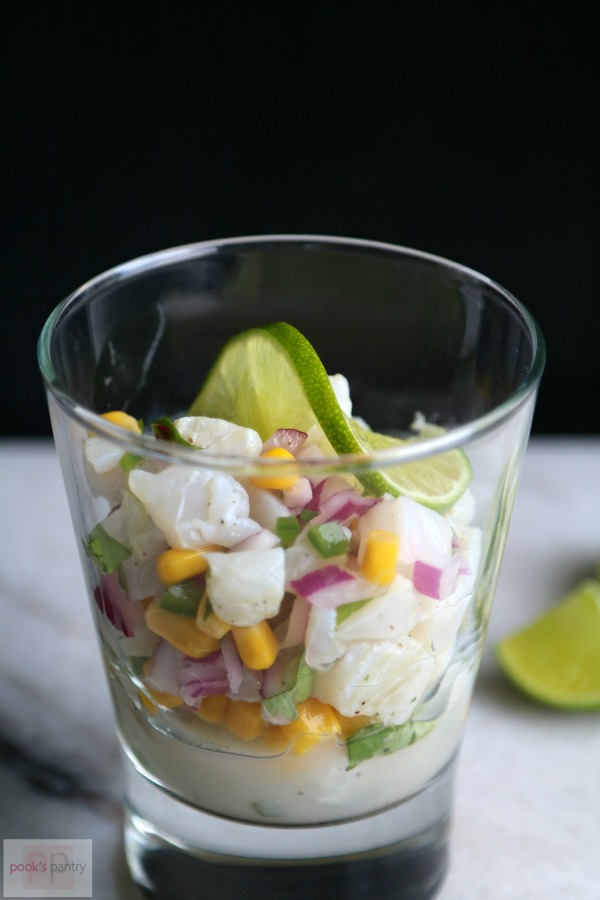 Ceviche with Fresh Summer Sweet Corn, Red Onion and Jalapeño in clear glass