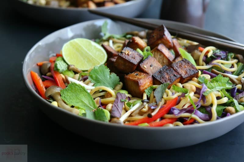 shallow gray bowl with crispy tofu on top of Asian noodles