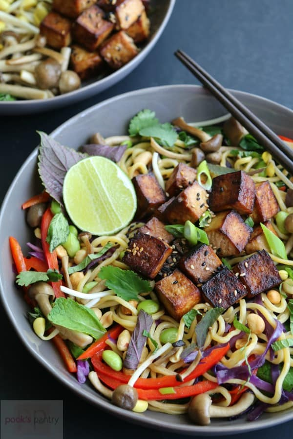 vegan tofu noodle bowl with chopsticks