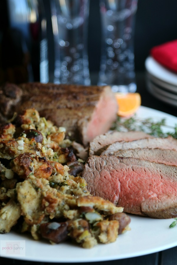 Beef Tenderloin Roast on white platter with chestnut stuffing