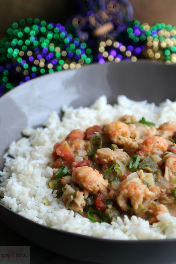 Langostino Étouffée with rice in gray bowl