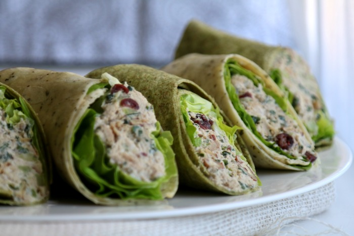 cranberry chicken salad wraps with lettuce on platter