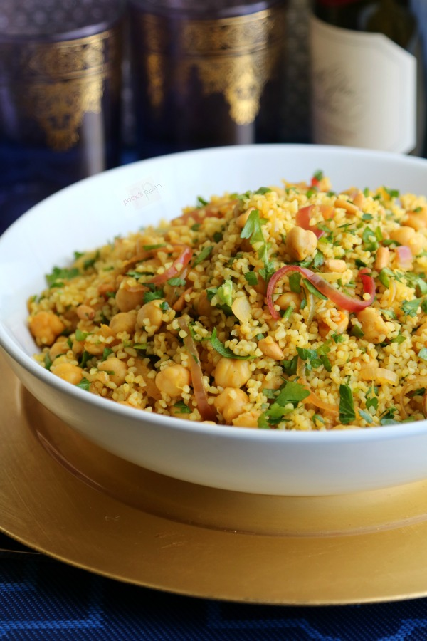 warm bulgur wheat salad in white bowl