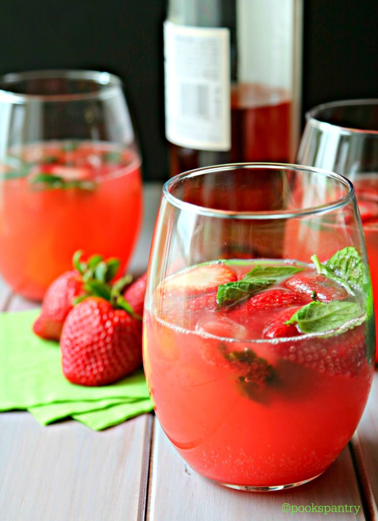 watermelon smash with strawberries and mint in clear glass