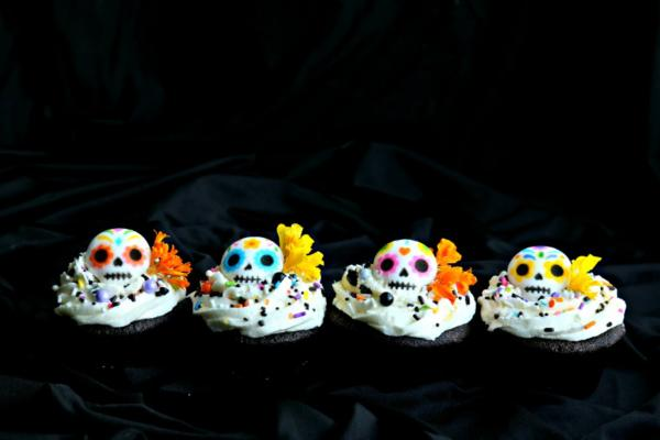 Day of the dead cupcakes with flowers and sugar skulls