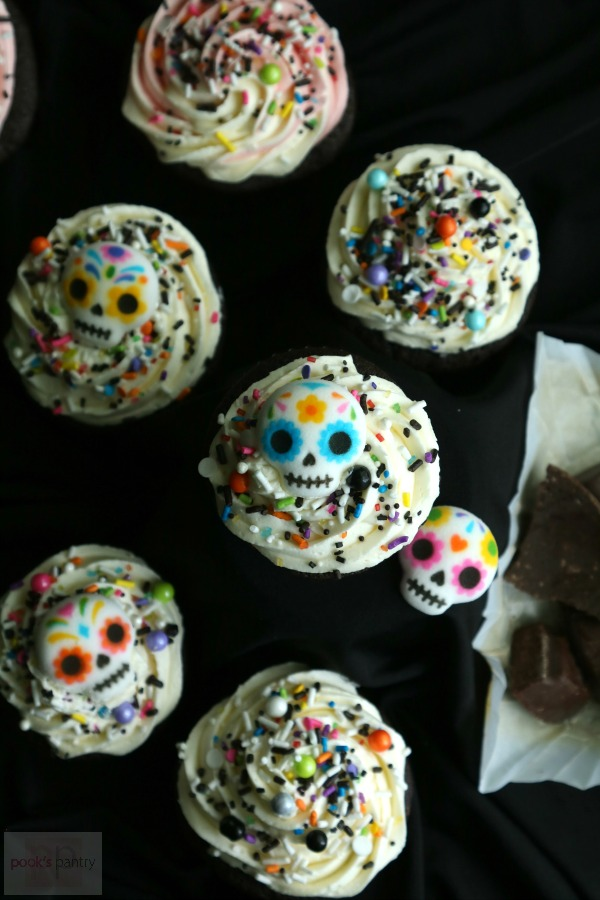 Day of the Dead cupcakes with sugar skull decorations and Mexican chocolate