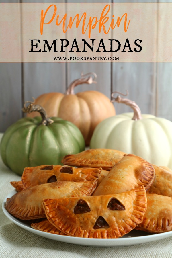 Pumpkin empanadas are only 30 minutes away with this quick and easy short cut recipe.  Seasoned with pumpkin pie spices and barely sweet, these treats make a great dessert or breakfast.