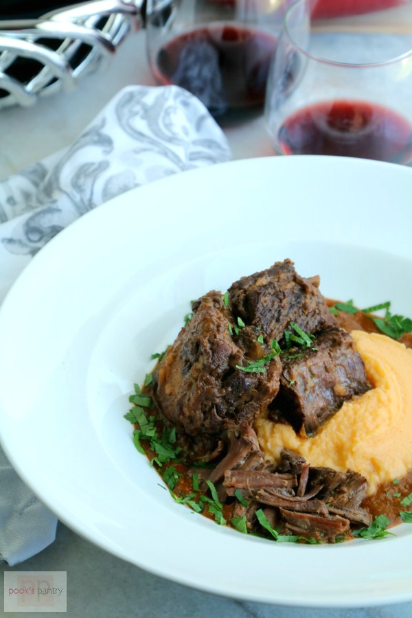 braised short ribs in white bowl with rutabaga